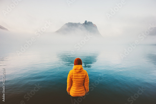 Photo  Woman alone looking at foggy sea traveling adventure lifestyle outdoor solitude