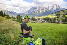 Cyclist On Bike Tour With Mountain Bike, On The Cycle Path Via Claudia Augusta, In The Back Ehrwalder Sonnenspitze, Crossing The Alps, Mountain Landscape, Alps, Ehrwald Basin, Near Ehrwald, Tyrol, Austria, Europe