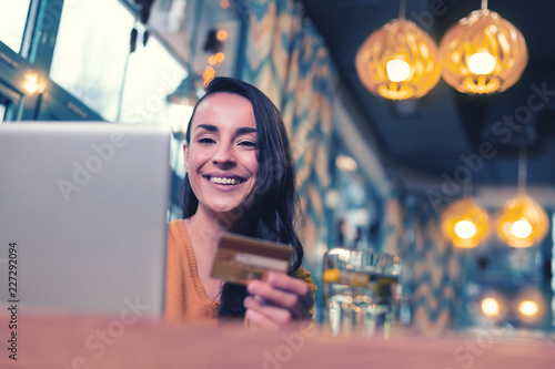 canvas print motiv - zinkevych : Work with pleasure. Beautiful brunette expressing positivity while going to do online shopping