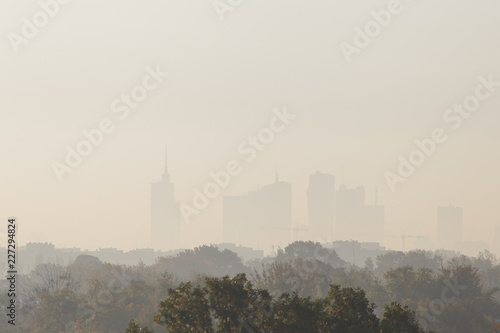 Fototapeta Warsaw, the capital of Poland covered in smog and fog