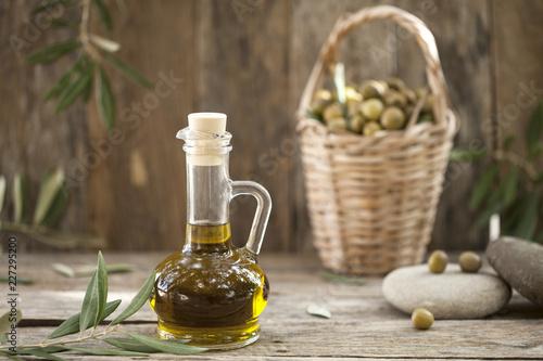 olive oil bottle over wooden table