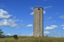 Old Grain Silo And Blue Sky