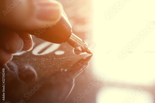 Fototapeta  Girl engraves on granite
