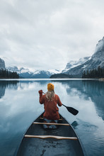 Girl Canoeing On A Lake