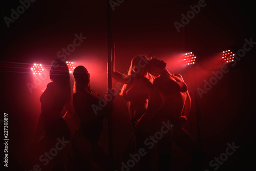 four slim sexy pole dance women team