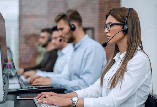Obraz young employee call center talking with the client - fototapety do salonu