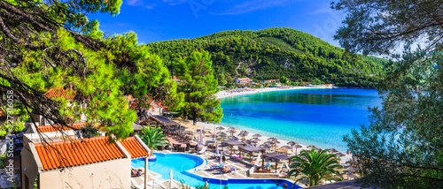 Greek holidays - beautiful Panormos bay. view with hotel and beach. Skopelos island