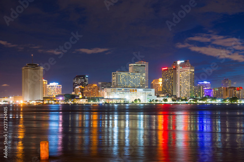 New Orleans skyline at twilight on Mississippi River in New Orleans, Louisiana, USA.