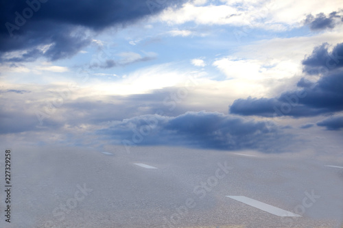Photo  Straight road with white markings to heaven