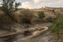 A Dry River Bed In A Forest. Drought In Río Eresma, Segovia. Spain