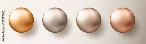 Valokuva Four realistic transparent spheres or balls in different shades of metallic gold color on white background