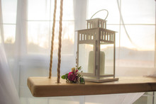 Wedding Background: Beautiful Lamp And Flower On Indoor Swing
