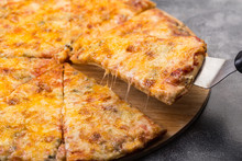 Tasty Sliced Pizza With Melted...