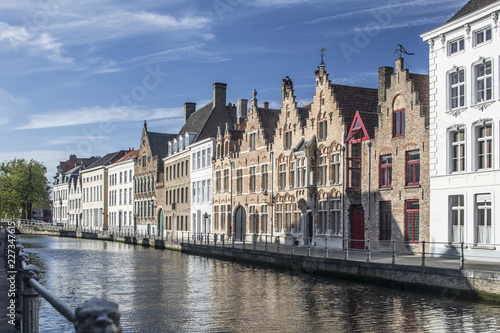 Sunny cityscape of old historical Belgium town Bruges. Urban landscape photography.
