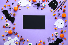 Halloween Candies With Decorations On Purple Background