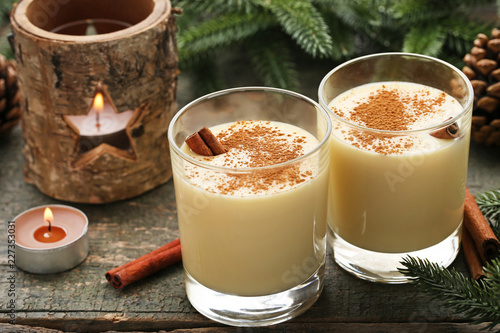 Staande foto Cocktail Eggnog in glasses with cinamon on wooden table