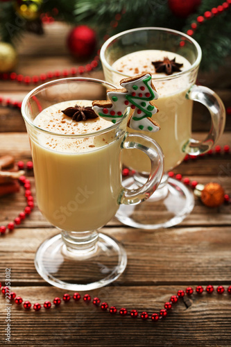 Staande foto Cocktail Eggnog in glasses with star anise on wooden table