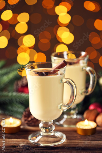 Fotobehang Cocktail Eggnog in glasses with cinamon and star anise on lights background