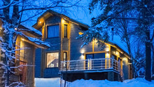 Country House In Winter. Two-storey Mansion. Cottage Illuminated With Lights. Camping. Country Trave. House In The Forest.