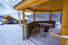 Country Rest. Terrace On The Street. Winter Veranda. Wooden House In The Forest. Gazebo Covered With Snow.