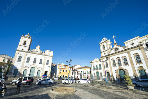 Stampa su Tela  Bright scenic morning view of the classic colonial churches lining the Largo Ter