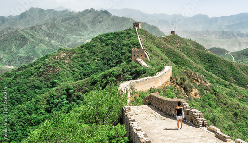 Foto auf Leinwand Chinesische Mauer The Great Wall Jinshanling section with green trees in a sunny day, Beijing, China