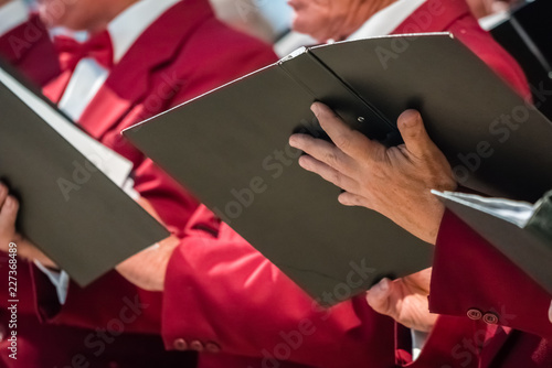 Canvas Print Mens choir members holding singing book