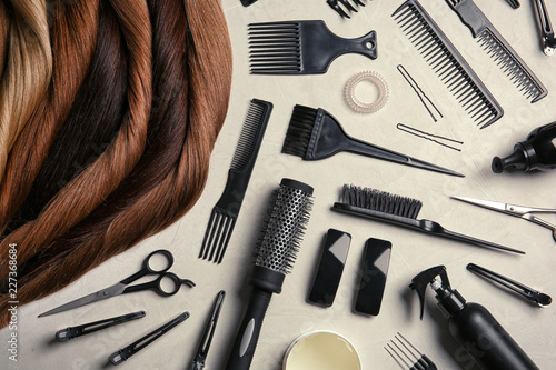 Fotografía Flat lay composition with different locks of hair and tools on color background