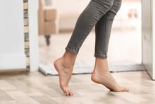 Young Woman Walking Barefoot At Home, Closeup. Heating Concept