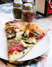 Eggplant Pizza On A Paper Plate.