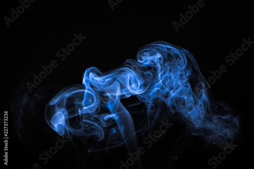 Fotobehang Rook Colored smoke on a black background