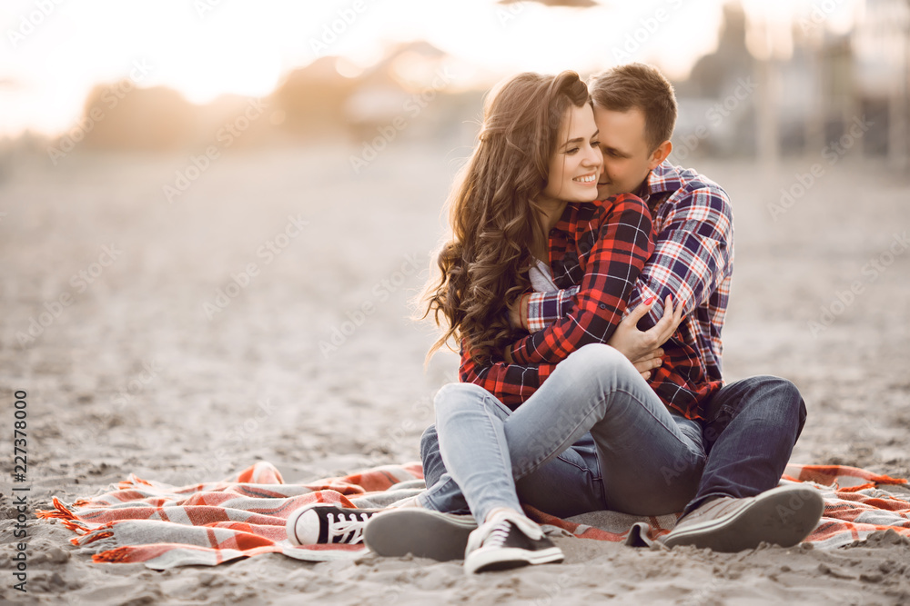 Fototapety, obrazy: Loving couple embracing on the beach