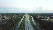 Aerial Footage Of Florida Turnpike With Cars Driving.