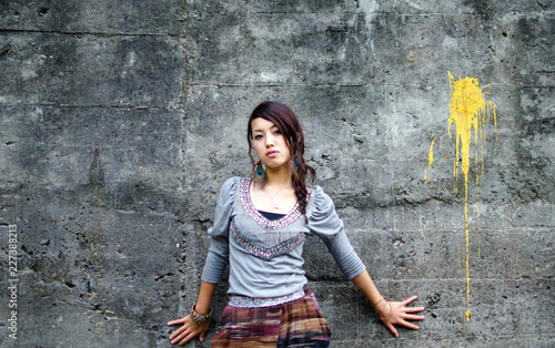 Japanese Girl poses on the street in Nakameguro, Japan. Nakameguro is a town located in the nice area of Tokyo.