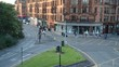 Time Lapse featuring a busy junction in Glasgow at rush hour as cars, taxis, vans and busses queue up and pass through. In the background are Glasgow's signature tenement buildings.