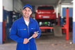 Portrait Of A Car Mechanic Holding Spanner