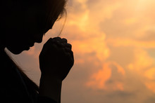 Silhouette Of Woman Hands Pray...