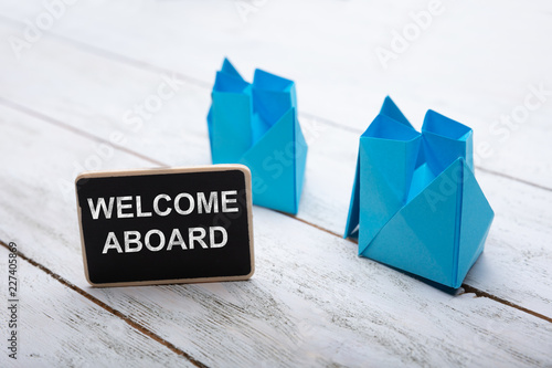 Photo Close-up Of Welcome Aboard Text On Slate