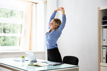 Businesswoman Stretching Her A...