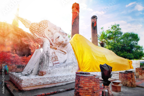 Tuinposter Boeddha Big white cement buddha statue wearing a yellow coat and pagoda with sunlight at Wat Yai Chaimongkol (Chaimongkhon), Phra Nakhon Si Ayutthaya, Thailand. Beautiful of historic city at buddhism temple