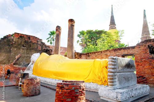 Tuinposter Boeddha Big white cement buddha statue wearing a yellow coat and pagoda with sunlight at Wat Yai Chaimongkol (Chaimongkhon), Phra Nakhon Si Ayutthaya, Thailand. Beautiful of historic city at buddhism temple