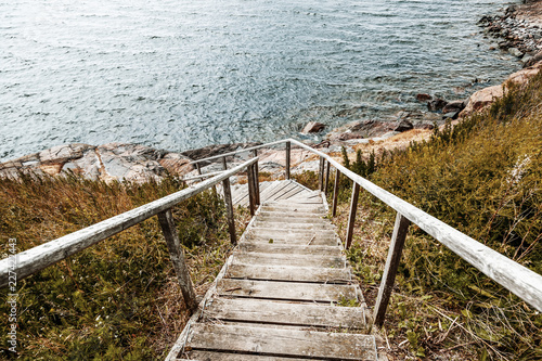Wooden paths stairs along the coast on the island of Suomenlinna, a beautiful seascape. Islands of Finland