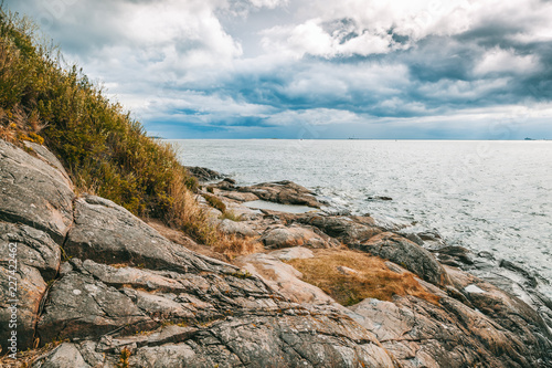 Beautiful seascape, the stone coast of the sea on the islands of Finland. The nature of Northern Europe