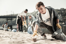 Clean Up. Smiling Handsome Boy Wearing Sport Jacket Walking With Garbage Bag Along The Beach And Cleaning Up Trash