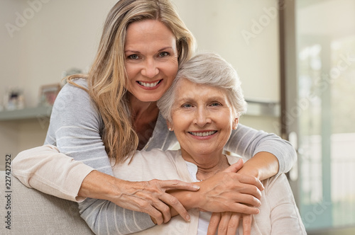 Woman hugging mother with love