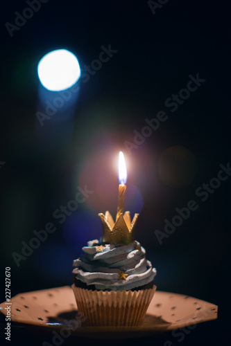 A Small Cake With One Burning Candle On Dark Background Holiday Birthday Year Old
