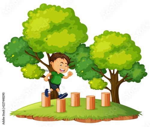 Staande foto Kids A boy jumping on the wood