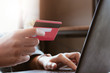 woman asian making online payment on laptop computer with credit card for shopping on onlines retail shop at home
