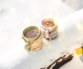 Obraz na płótnie Canvas Two cups of tea on background of a winter landscape
