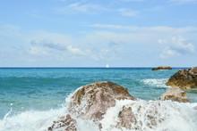Waves Splash Against Rocks On ...